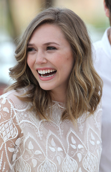 "Elizabeth Olsen Elizabeth Olsen - the younger sister of Mary-Kate and Ashley Olsen - looks lovely in lace at the ""Martha Marcy May Marlene"" photocall in Cannes. The photocall was held as part of the 64th Cannes Film Festival at the Palais de Festivals on Croisette Avenue, Cannes."