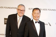 George Takei and Brad Altman at the 21st Annual Elton John AIDS Foundation Academy Awards Viewing Party held at the Pacific Design Center in West Hollywood, Los Angeles.