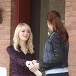 She shakes hands with Emma Stone on the set.