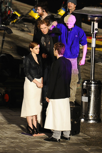 Emma Watson Emma Watson continues filming the latest ad for Lancome with director Mario Testino in Paris. The 'Harry Potter' star is seen wrapped in a towel in between takes with her male co-star.