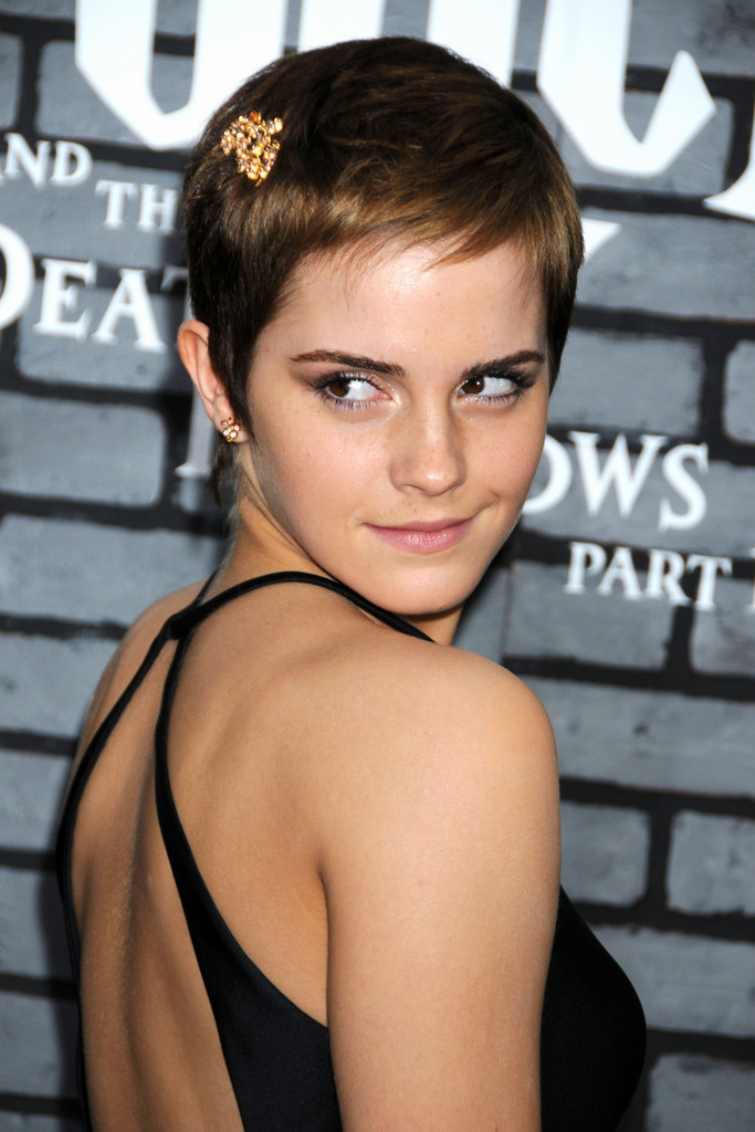 "Emma Watson at the New York premiere of ""Harry Potter and the Deathly Hallows: Part 1"" at Alice Tully Hall. Emma was wearing a custom designed Calvin Klein Collection black double silk satin halter dress, paired with Calvin Klein Collection black copper anklet sandals from the Spring 2011 collection."