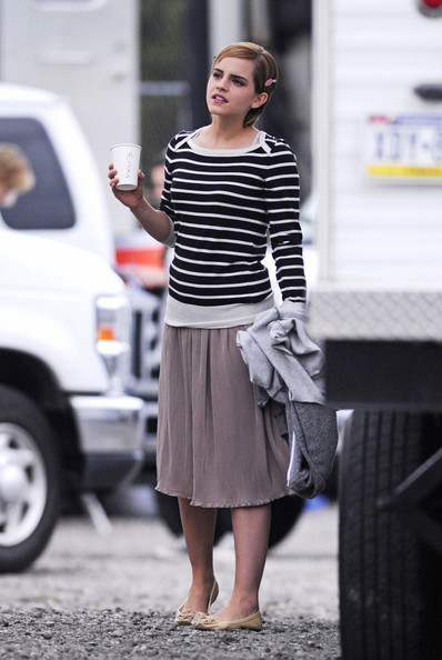 "Emma Watson finishes getting her makeup done on the set of ""Perks of Being a Wallflower"" in NYC. The young ""Harry Potter"" star, allegedly worth more than $32 million, is all smiles as she holds a warm beverage in her hand."