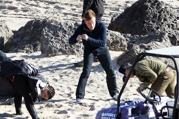Ewan McGregor suffers a beating from his co-star Gina Carano while on the beach for the upcoming film 'Haywire'. The 39 year old Scottish actor sported a shorter hairstyle for his role in the film.