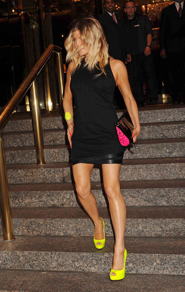 Fergie Fergie wears a short black dress and neon green heels as she leaves the Trump Hotel in NYC. Her bodyguard Pascal, who can be seen walking behind her, was reported to have helped a sick man on a flight from New York to LA back in May.