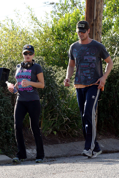 Fergie and husband Josh Duhamel are spotted out for a jogging session around their neighborhood. Fergie was seen wearing shirt with the phrase