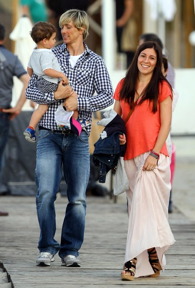 Family photo of the football player, married to Olalla Dominguez, famous for Atlético de Madrid.