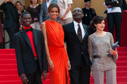 Souleymane Deme, Anais Monory, director Mahamat Saleh Haroun and producer Florence Stern arriving at the 'Grigris' screening held at the Palais Des Festivals as part of the 66th Cannes film Festival in Cannes.