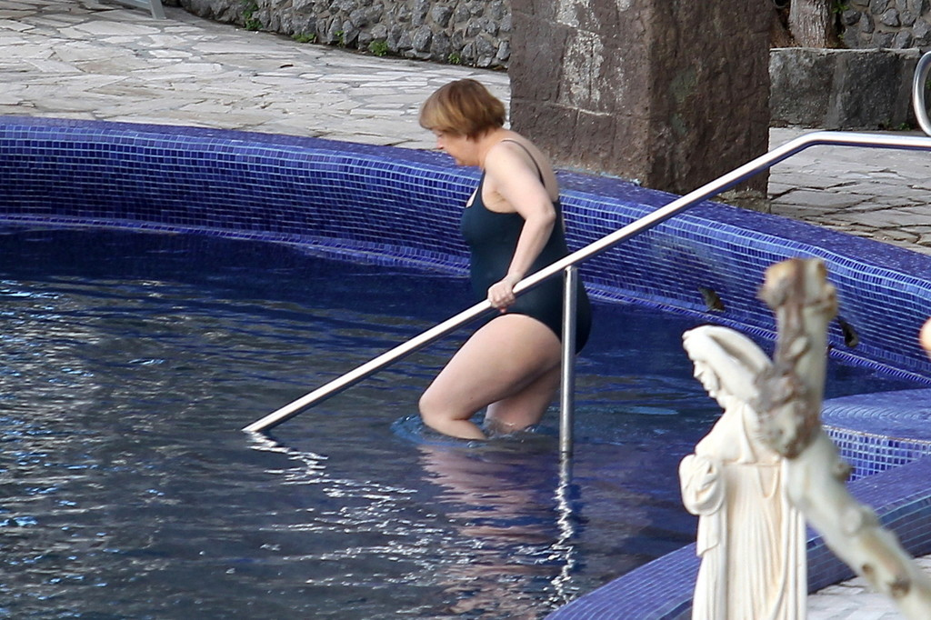 German Chancellor Angela Merkel Arrives To Take A Bath In The Swimming Pool Of The Aphrodite