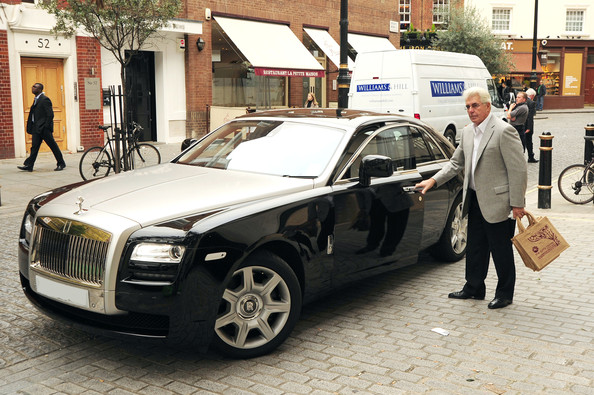 Max Clifford Arrives at His Office