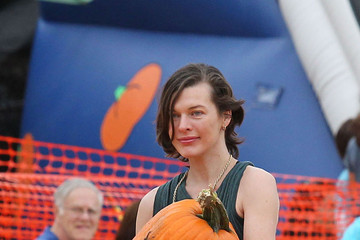 Ghost Milla Jovovich prepares for Halloween at the pumpkin patch with husband Paul Anderson and the couples daughter, Ever Anderson, in Los Angeles
