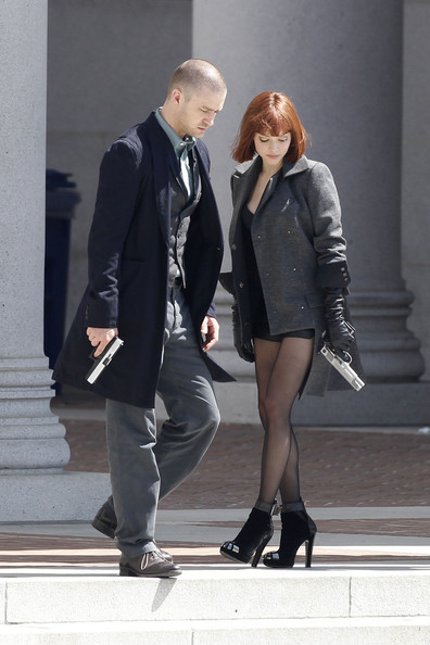 "Gun-toting Justin Timberlake and ""In Time"" co-star Amanda Seyfried spotted shooting a scene for their new film in downtown Los Angeles. Off camera, Timberlake and Seyfried share a few laughs between takes. Seyfried also showed off her slim figure by removing her overcoat and revealing a sexy play suit due to the heat. Seyfried was also seen drinking a Diet Coke to combat the warm weather on set."