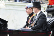 on the balcony of Buckingham Palace for the Queen's Birthday Parade, the Trooping the Colour. William, the Duke of Cambridge, took part in the parade for the first time while his new wife, Kate watched.