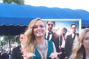 Heather Graham signing autographs during the premiere of 'The Hangover Part 3' in Los Angeles