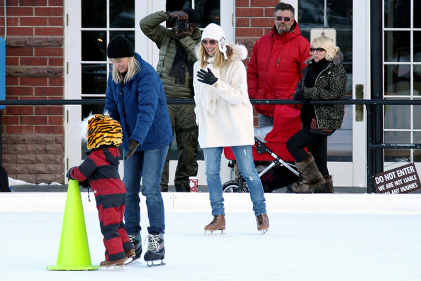 Heidi and husband Seal take their kids ice skating while spending their holiday in Aspen. Heidi strapped on a pair of ice skates to accompany her kids Helene, Henry and Johan on the ice. The kids were wearing animal shaped helmets and one piece jump suits. Seal kept to his sneakers and camera, taking pictures of wife Heidi and his kids skating around the rink.
