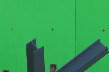 """Helicopter Henry Cavill, star of """"The Social Network,"""" films scenes for the new """"Superman"""" movie against a giant green screen"""