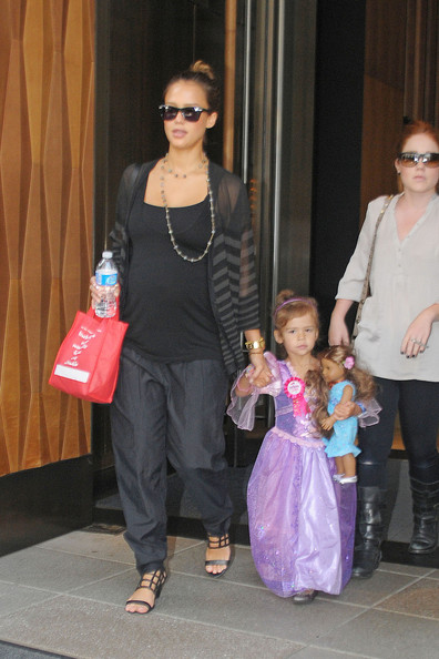Honor Marie Warren holds tightly onto mom Jessica Alba's hand after celebrating her 3rd birthday at Bubby's in Tribeca. The adorable tot is seen wearing a purple princess costume gown and holding onto her toy doll, and her very own 'Birthday girl' button.