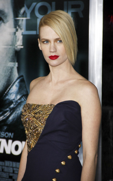 "January Jones January Jones at the Los Angeles premiere of ""Unknown"" held at the Regency Village Theatre, Los Angeles. .She was wearing an Alexander McQueen Pre-Fall 2011 navy strapless dress has a gold embroidered detail in the bodice and gold military buttons cascading down the asymmetrical skirt."