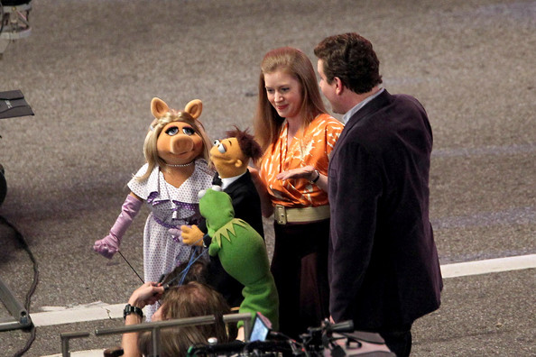 Jason Segel and Amy Adams make a song and dance of it on the set of the new Muppets movie, shooting overnight in LA. Whilst Amy looked at home with the dance number, Jason appeared a little clumsy, even accidentally revealling his partner's panties at one stage! The big production number was shot overnight on Hollywood Boulevard.