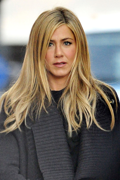 "Jennifer Aniston leaves her trailer on the set of the upcoming comedy film ""Wanderlust"". The actress let her hair down and at one point waved to photographers, exposing part of her stomach."