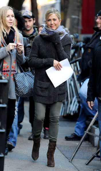"Jennifer Aniston seen warming up with a sweater and scarf on the set of the upcoming comedy ""Wanderlust"" at the Bryant Park Subway station."