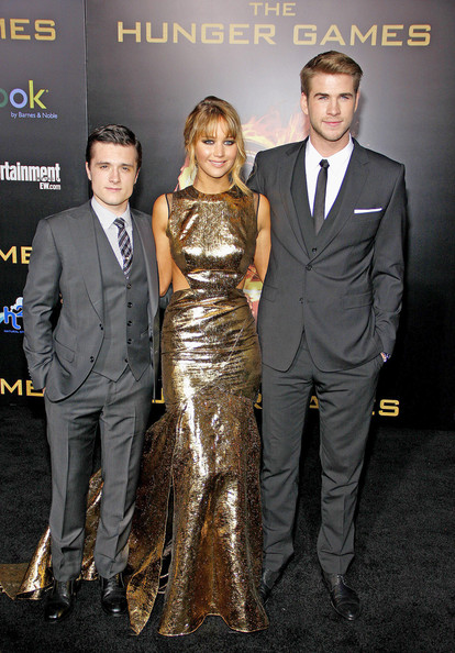 "Josh Hutcherson, Jennifer Lawrence and Liam Hemsworth at the Los Angeles premiere of ""The Hunger Games"" held at the Nokia Theatre L.A. Live, Los Angeles."