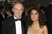 """Francois-Henri Pinault and Salma Hayek at the annual Costume Institute Gala in New York, celebrating the exhibition of """"Alexander McQueen: Savage Beauty"""", held at the Metropolitan Museum Of Art on 5th Avenue."""