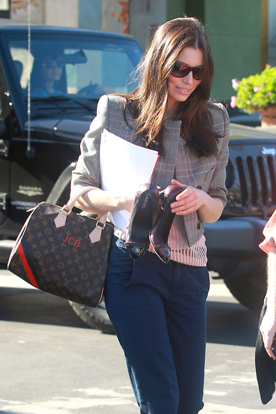 "Jessica Biel Jessica Biel, carrying an initial embroidered Louis Vuitton bag and Chanel high heels, arrives at a nail salon for a manicure and pedicure. The sexy Hollywood actress is rumored to be screen testing at Warner Brothers for the female role in the upcoming ""The Dark Knight Rises""."