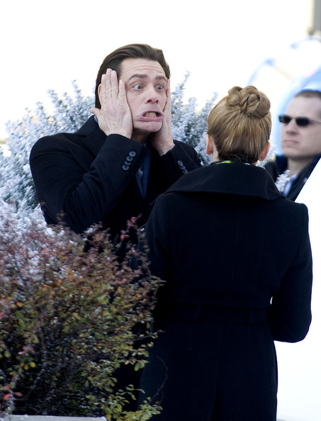 """Jim Carrey spotted on the set of """"Mr. Popper's Penguins,"""" stretching his face in front of his co-star Ophelia Lovibond."""