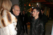 Joe Jonas steps out of his filthy car for an improtu chat with talk show supremo Larry King and his wife, Shawn. Joe had been dining at the same Beverly Hills restaurant as Larry, but the pair clearly hadn't met whilst inside the eatery. King, who handed over the reigns to his CNN prime time slot to British journalist Piers Morgan last month, approached the teen heart-throb as he was about to drive away. The septugenerian seemed keen to introduce his wife to the Disney star, and Joe appeared only too willing, jumping out of his dusty vehicle to meet her. After their meet and greet, Joe drove off into the night whilst Larry and Shawnhapiily posed for photographers as they waited for their vehicle to be returned by the valet.