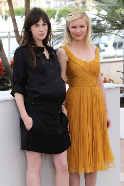A pregnant Charlotte Gainsbourg and Kirsten Dunst attend the  'Melancholia' photocall at the 64th Cannes Film Festival.