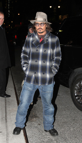 "Johnny Depp poses for photographs after making an appearance on ""The Late Show with David Letterman"" despite freezing temperatures in New York City. Depp is currently promoting his new film ""The Tourist"", which co-stars Angelina Jolie."
