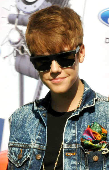 Justin Bieber Teen heartthrob Justin Bieber makes a surprise visit to the 2011 BET Awards at the Shrine in Los Angeles. The 17- year-old star was presenting the Best Male Hip-Hop Artist award with Nicki Minaj.