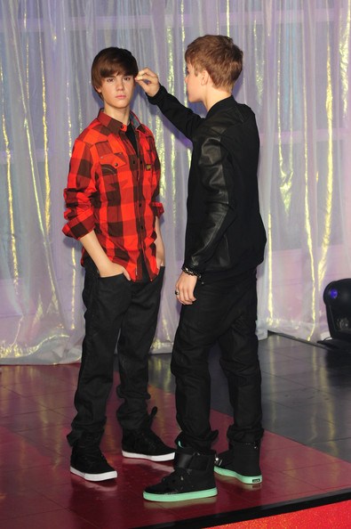 Justin Bieber Justin Bieber and his mother Pattie Mallette unveil his wax figure at Madame Tussauds in London.