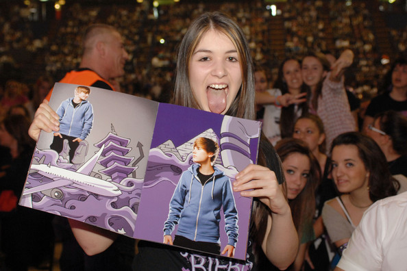 "Justin Bieber Justin Bieber fever breaks out in Italy! Thousands of screaming girls (and a few embarrassed-looking dads!) watched their idol perform songs on his ""My World"" tour. On stage, Bieber appeared to using a few of Michael Jackson's classic moves. The 17-year-old was seen grabbing his crotch, standing with his arms outstretched and wearing bandages on two of his fingers."