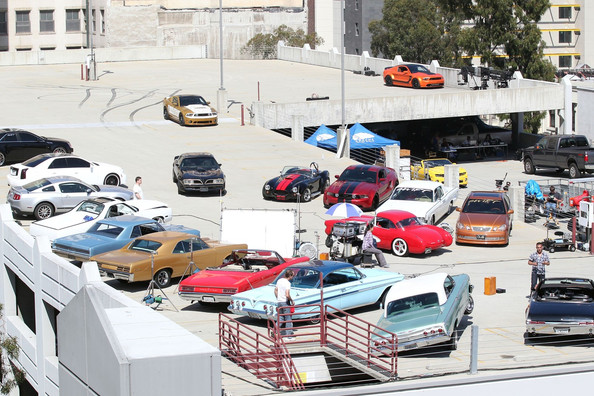 "Pop star Justin Bieber drives one of the many classic cars featured on the set of his new music video ""Boyfriend"" as they filmed in Los Angeles."