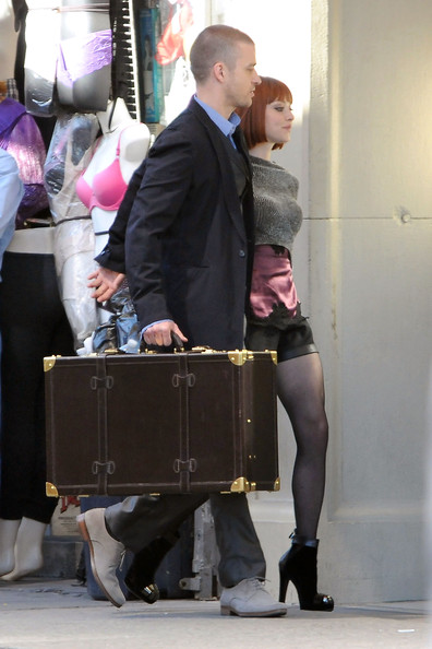 "Justin Timberlake and Amanda Seyfried film a scene together for their upcoming science fiction movie ""Now"". In the scene, Timberlake wore a long coat and carried a large suitcase as he walked arm in arm with a scantily clad Seyfried."