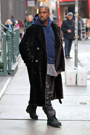 Kanye West worked a pair of black combat boots during a stroll in New York City.