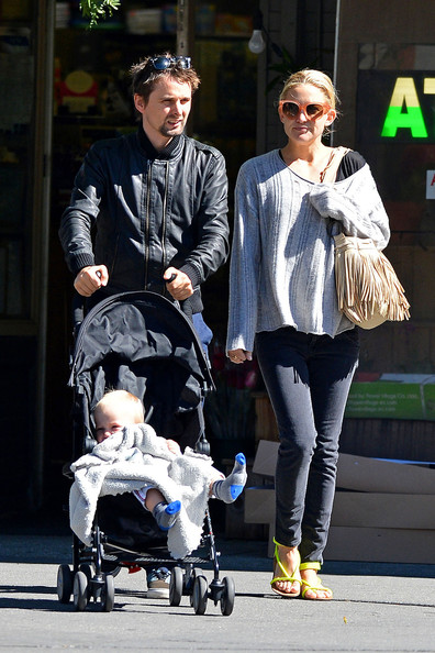 Kate Hudson and fiance Matt Bellamy take their baby son Bingham for a walk in New York City. The actress and her rocker beau looked laid back as they strolled through the Big Apple with their adorable little one keeping warm with a pair of knit socks.