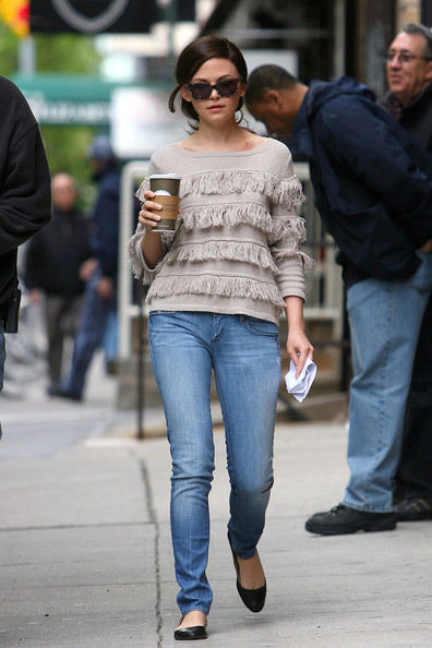 "Ginnifer Goodwin walks to the set of the upcoming film ""Something Borrowed"", carrying a cup of coffee and a folded up piece of paper."