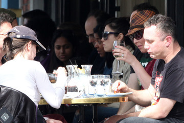 Katherine Heigl Tory Burch Katherine Heigl, seen wearing Tory Burch flats and a fedora, dines at Figaro for lunch in Los Feliz with her mother