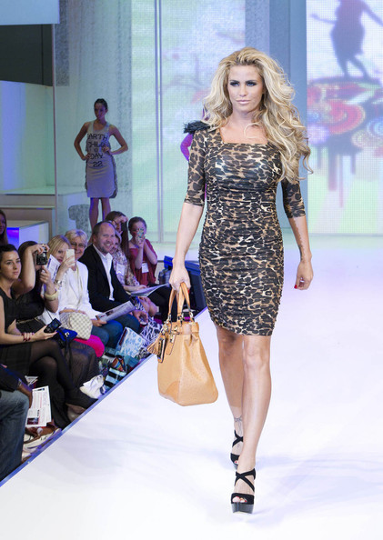 Katie Price - Catwoman! A glamorous Katie Price launches her new Day 22 collection in London