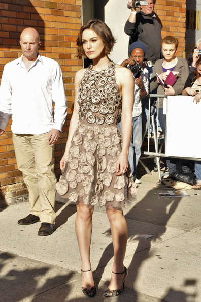 "Keira Knightley stops to sign some autographs and pose for pictures before an appearance on ""The Daily Show with Jon Stewart""."