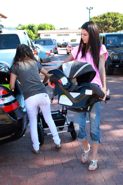 Kendall Jenner Kourtney Kardashian (grey t-shirt) and sister Kendall Jenner (pink t-shirt) indulge in some retail therapy whilst baby Mason waits patiently in his buggy!. Accompanied by an unidentified blonde friend, the ladies perused some stores at the Malibu Beach Mall before heading home.