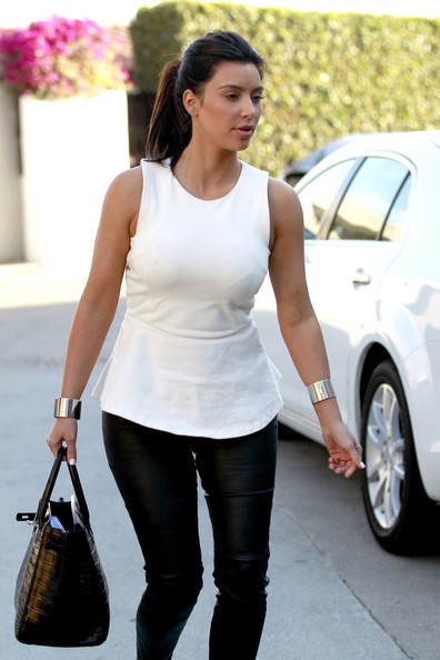 Kim Kardashian - Kim Kardashian and Kanye West are spotted leaving Kanye's house in Los Angeles wearing coordinating white tops and leather pants