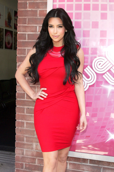 "Kim Kardashian Kim Kardashian poses up in a red dress and nude Christian Louboutin platform heels as she arrives at the ""The Wendy Williams Show"" to promote the Tria home laser hair removal product."