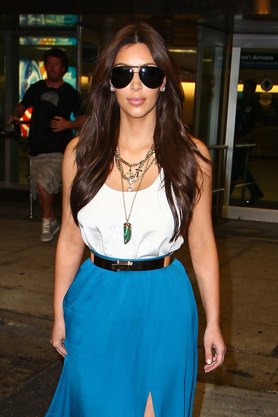 Kim Kardashian - Kim Kardashian, wearing a flowing skirt and white tank top, touches down at the Miami International Airport