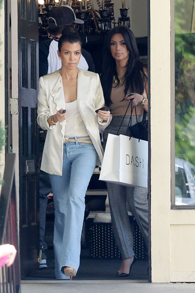 Kim Kardashian Kim and Kourtney Kardashian are seen out shopping and filming scenes for their reality show at their family owned clothing boutique Dash. The pair, looking stylish as always with Kim wearing a gold necklace with a matching watch, were followed by a camera crew as they left the store.