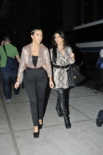 "Kim Kardashian Kim and Kourtney Kardashian go out for a bite to eat while filming for their new reality show ""Kim and Kourtney Take New York"".  The ultra sexy Kim Kardashian sports a snake skin dress with thigh high Louboutins.  Siser Kourtney is seen wearing tight black pants and black Louboutin stilettos."