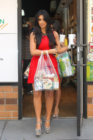 "Kim Kardashian Tuesday, August 30 2011. Kim and Kourtney Kardashian film scenes for their show ""Kim and Kourtney Take New York"". The Kardashian sisters are seen shopping at an organic market for groceries before they head home."