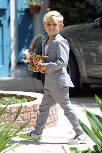 Kingston Rossdale Gwen Stefani celebrates Easter with husband Gavin Rossdale and their two sons, Kingston and Zuma, who were dressed to impress. Kingston and Zuma could both be seen wearing nail polish although Kingston's was multicolored, keeping with the Easter festivities. Kingston could also be seen putting his toy lion inside the house before coming back out to help bring items in from the car, including a giant rabbit pinata. At one point, Gavin came out to pass on some of the Easter spirit to the paparazzi by giving them chocolate bunnies and mini Easter eggs. Gwen was also dressed to impress, wearing high heels, leather pants, a white floral lace top and two gold cross necklaces. During the Easter party, Gwen's brother was spotted playing the guitar for friends on the front lawn.